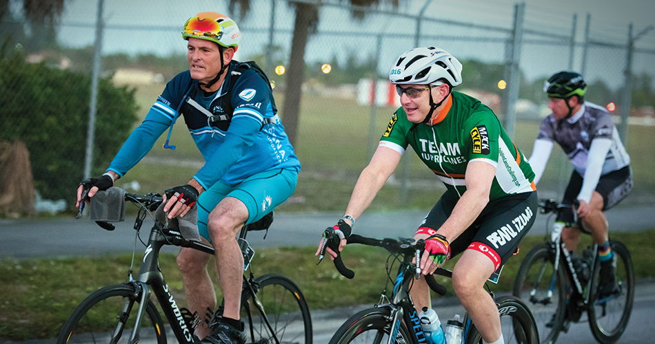 Stuart A. Miller (left), Former Chairman of the University of Miami Board of Trustees, cycles alongside Sylvester Director Stephen D. Nimer on the DCC Hurricanes Hundred route, which follows 100 miles through iconic Miami and Fort Lauderdale landscapes.
