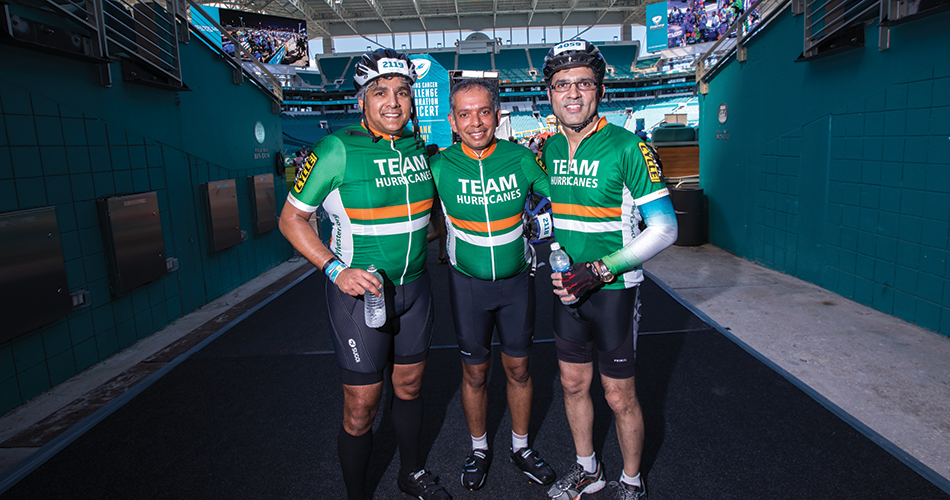 Sylvester Stem Cell Program Director Krishna Komanduri, M.D., (center) celebrates at the Hard Rock Stadium DCC finish line with his brother, Mohan Komanduri, (left) and Sylvester at Deerfi eld Beach Medical Director Mohammad Jahanzeb, M.D.
