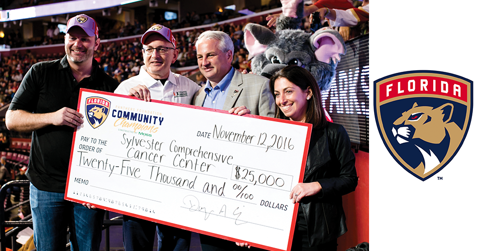Sylvester Director Stephen D. Nimer, M.D., second from left, receives the Florida Panthers donation from Panthers co-owner Doug Cifu (second from right).