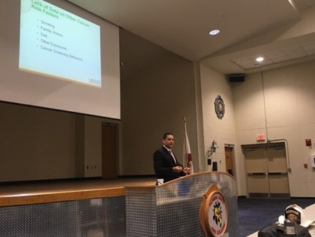Researcher speaks at a presentation about the Firefighter Cancer Initiative